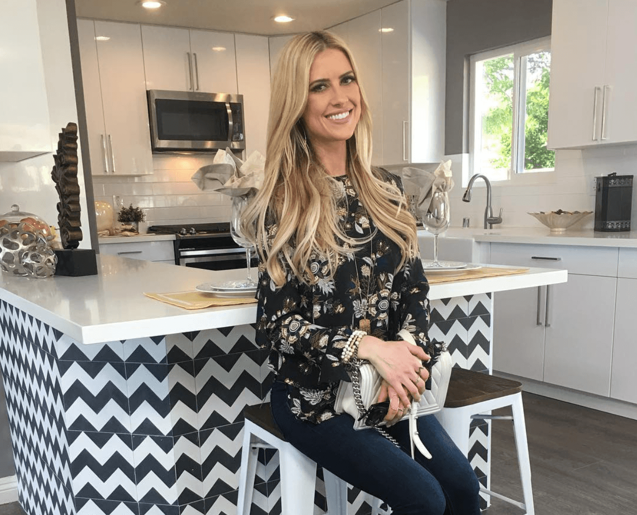 Christina El Moussa in a black and white kitchen