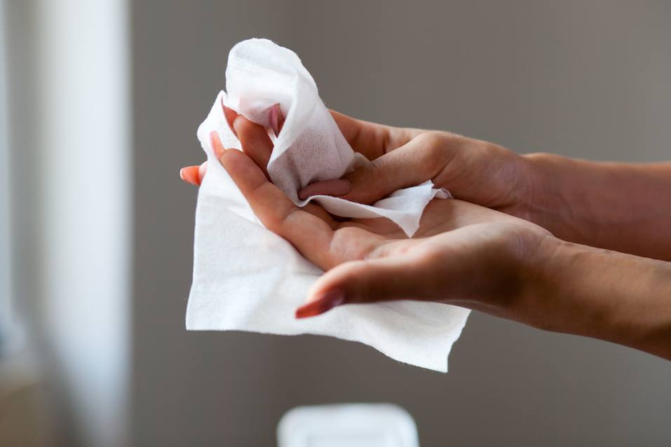 Cleaning fingers with wet wipes