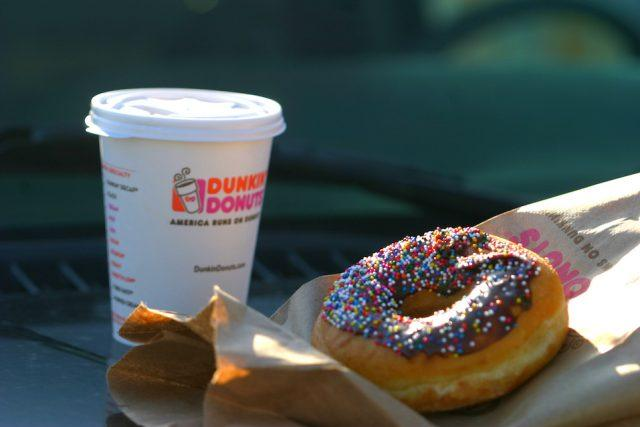 A Dunkin' Donuts coffee and doughnut.