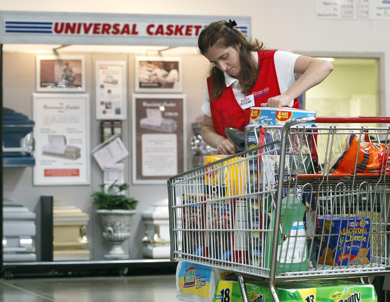 Costco employee scanning items