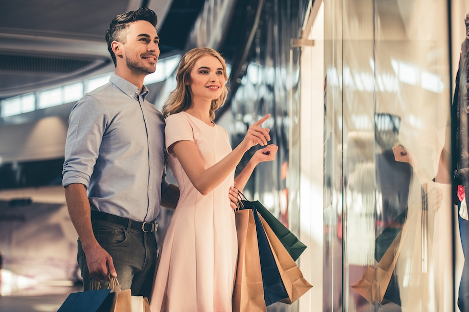Man and woman shopping at the mall
