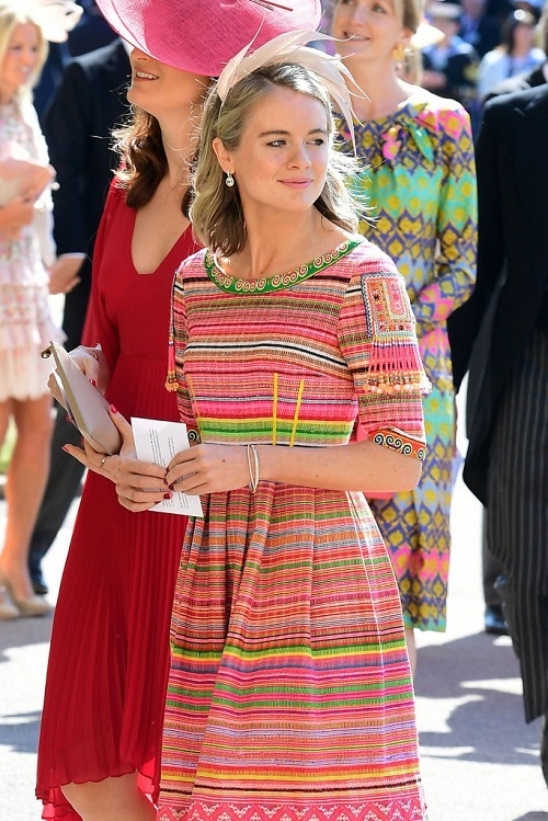 Prince Harry's ex, Cressida Bonas walking while in a colorful dress.