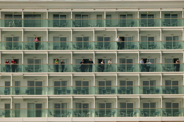 Passengers look out from balconies on world's largest ocean liner