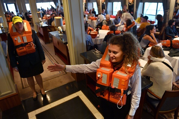 Passengers wear life jackets during a security exercise aboard the British cruise ship