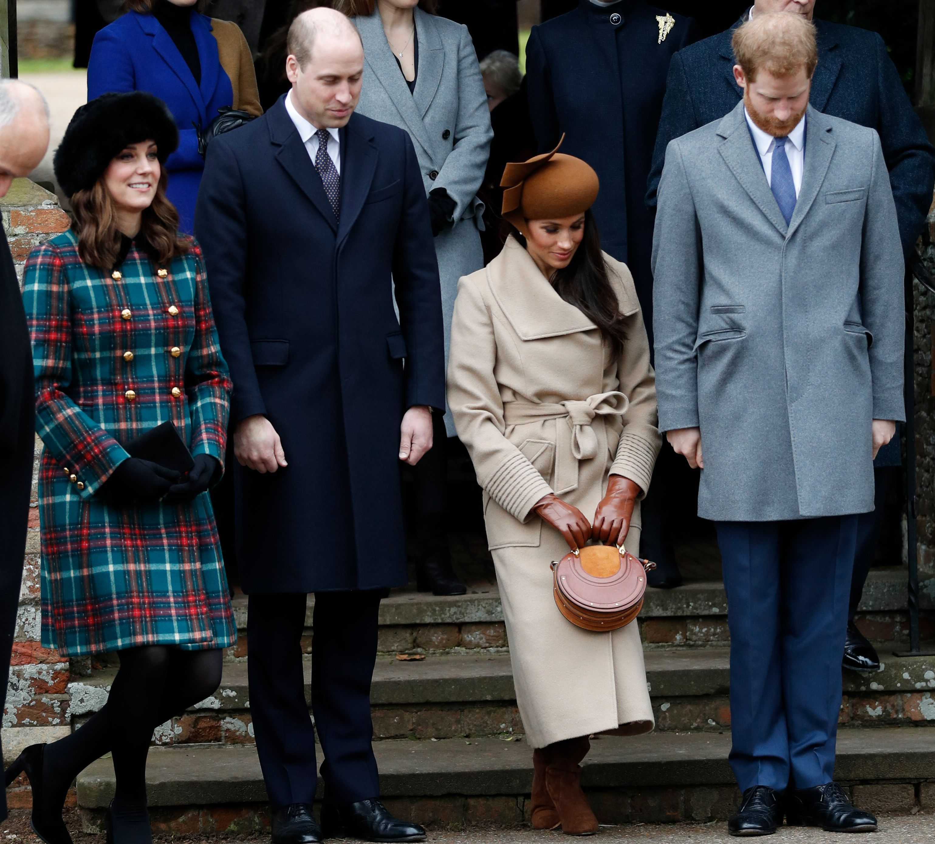 Kate Middleton and Meghan Markle curtsy to the queen