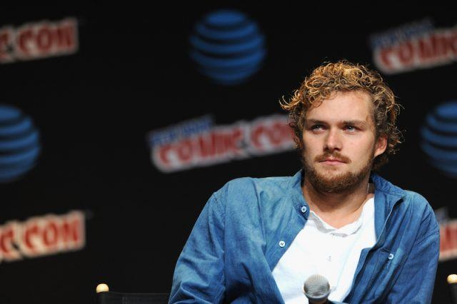 Finn Jones speaking on a Comic-Con panel.