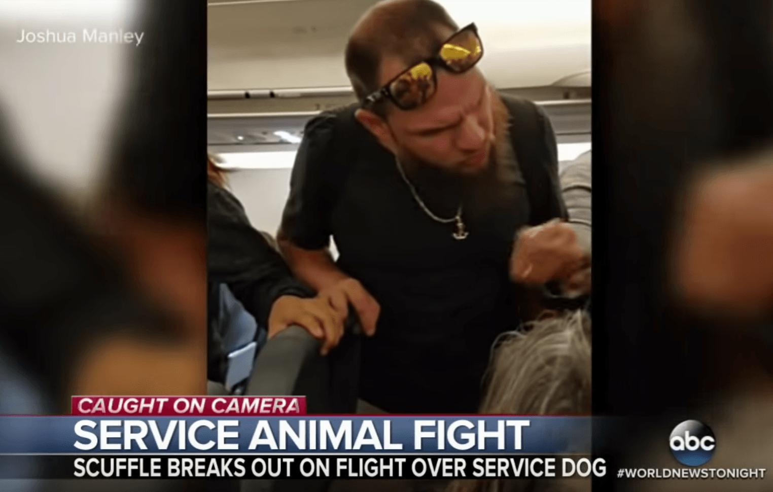 Deaf man threatening on plane over service dog
