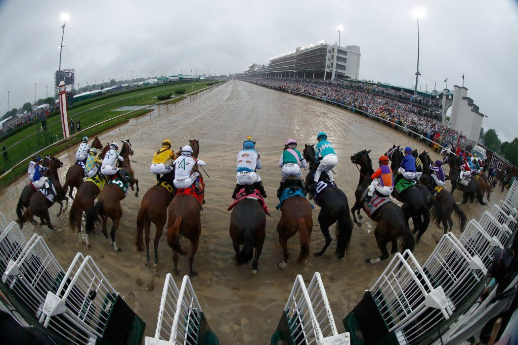 The field leaves the gate at the start of the 144th running of the Kentucky Derby at Churchill Downs on May 5, 2018 in Louisville, Kentucky.