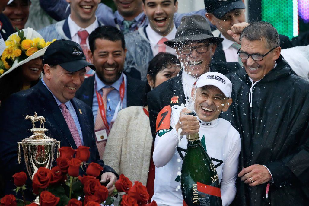 Jockey Mike Smith celebrates after winning the 144th running of the Kentucky Derby at Churchill Downs on May 5, 2018 in Louisville, Kentucky.