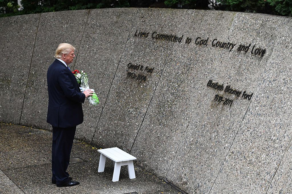 US Republican presidential nominee Donald Trump pays his respect at the former US President Gerald Ford