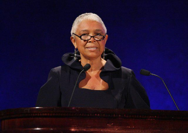 Bill Cosby's wife, Camille, making a speech at an event.