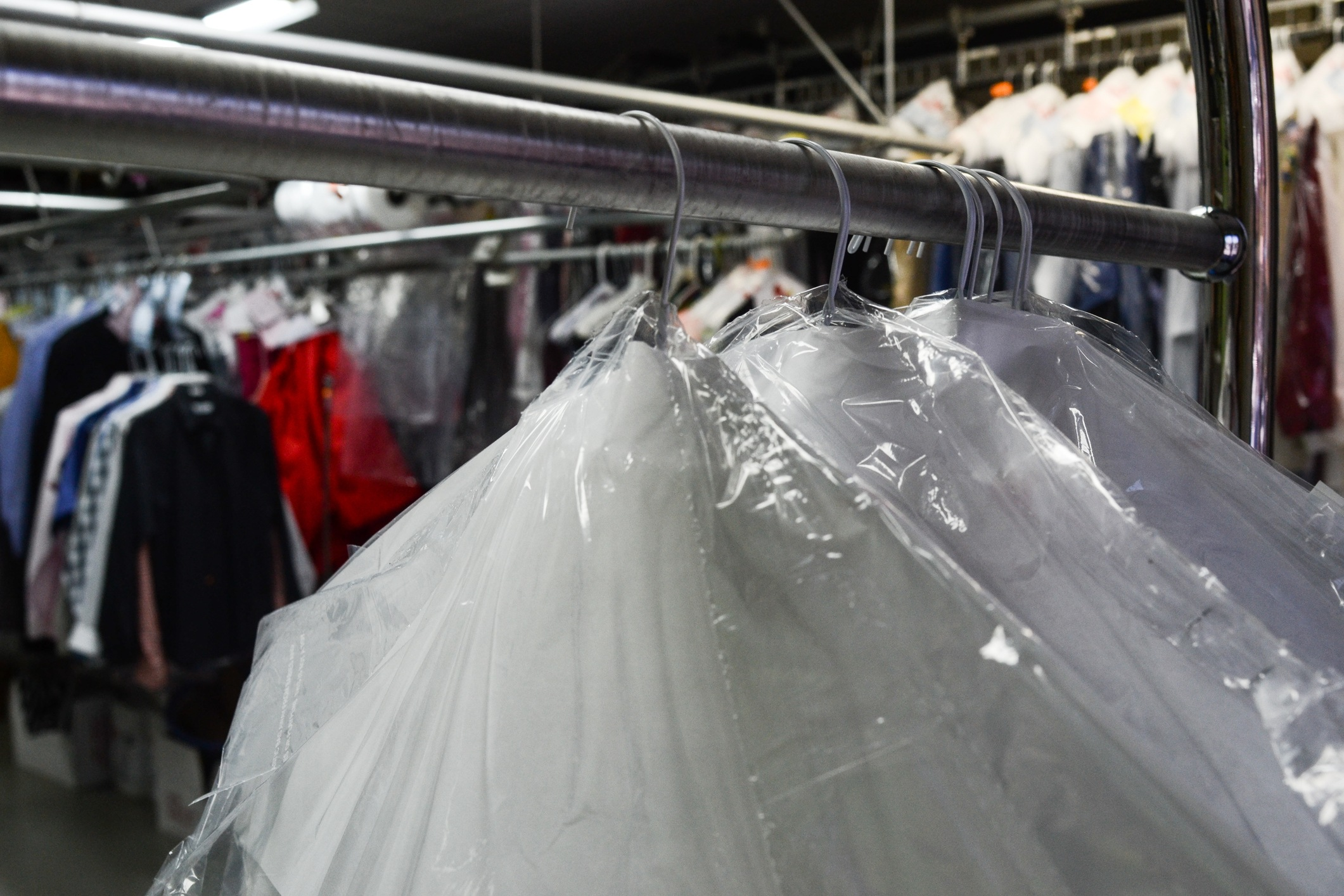 Dry cleaned clothes in plastic with business in back