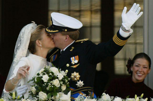 King Willem-Alexander and Queen Máxima of The Netherlands kiss on their wedding day.