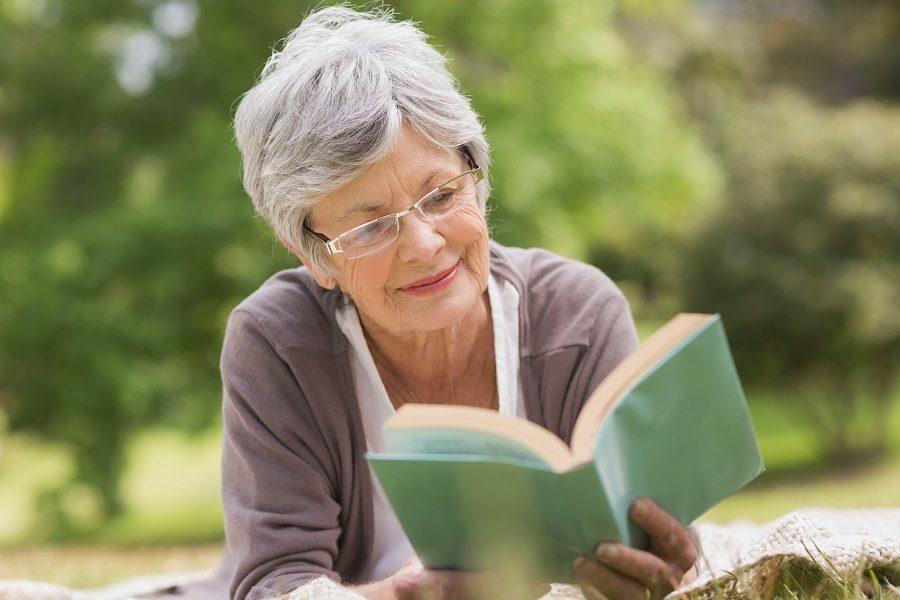 Elderly woman reading book