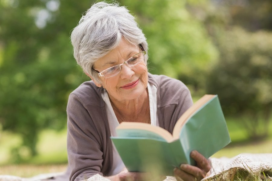 Elderly woman reading book