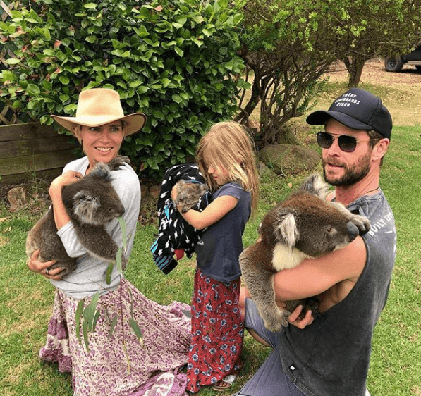 Chris Hemsworth and Elsa Pataky holding koala bears