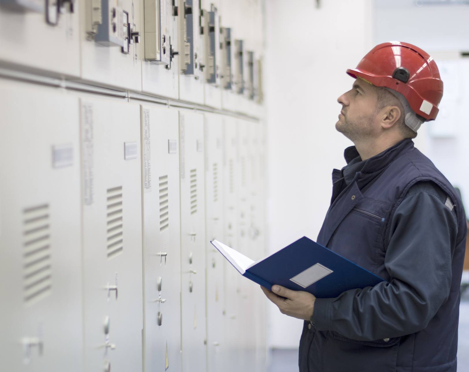 Technician Checks the Functionality of the Equipment in Electrical Room