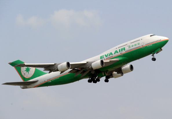 Eva air airplane is flying over the Sukarno-Hatta airport in Tangerang