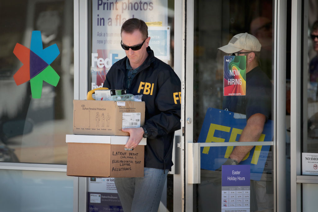 FBI Agents collect evidence in Austin FedEx bombing