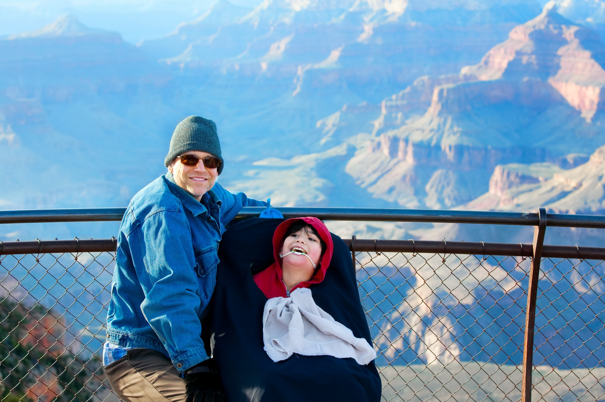Father with disabled son in wheelchair at Grand Canyon
