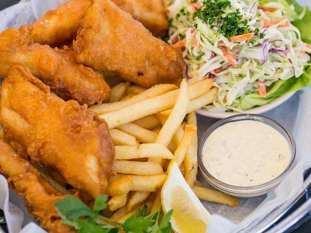 Fish and chips on a plate.