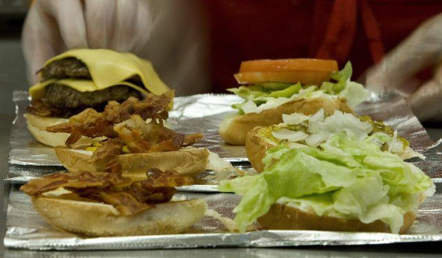 Five Guys burger on a tray.