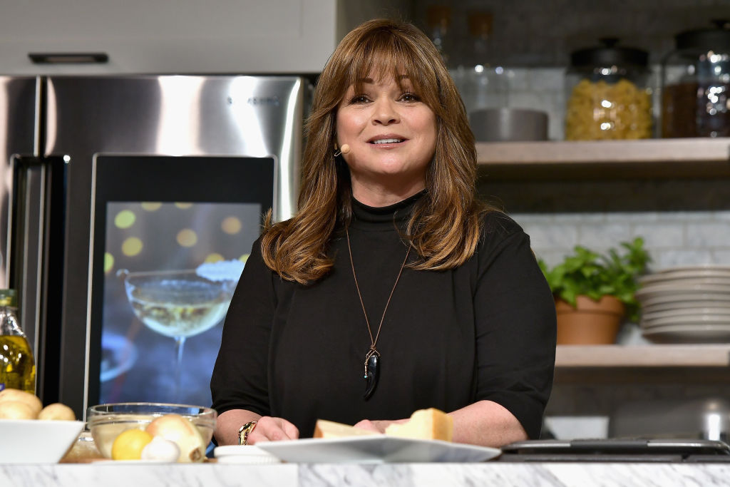 Valerie Bertinelli prepares a dish at the Food Network & Cooking Channel New York City Wine & Food Festival