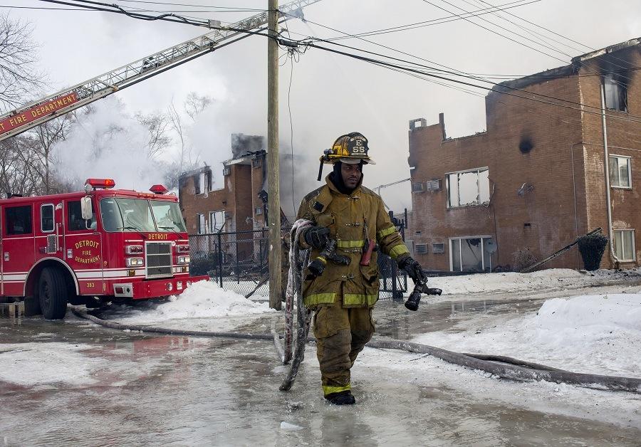Firefighters battle an apartment fire