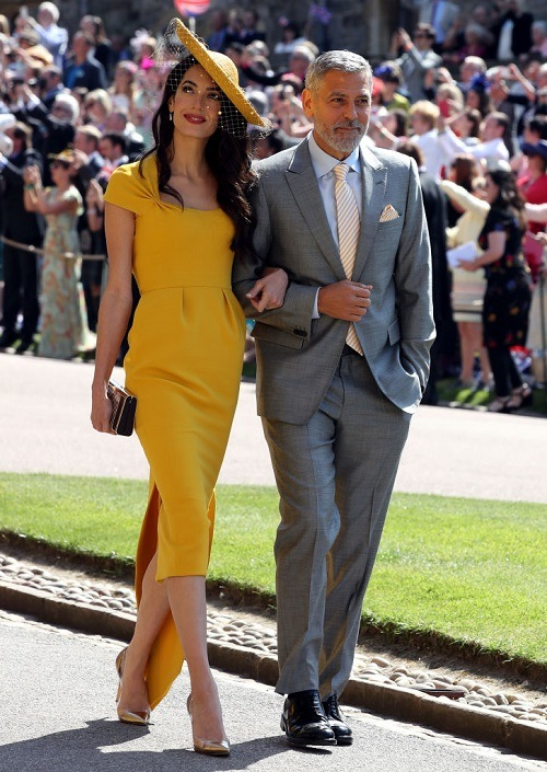 George and Amal Clooney walking together at the royal wedding.