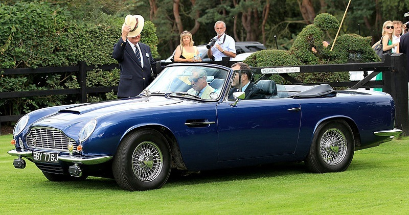 EGHAM, ENGLAND - JULY 25: Prince Charles, Prince of Wales arrves in his Aston Martin at Guards Polo Club for the Cartier International Polo Day on July 25, 2010 in Egham, England.