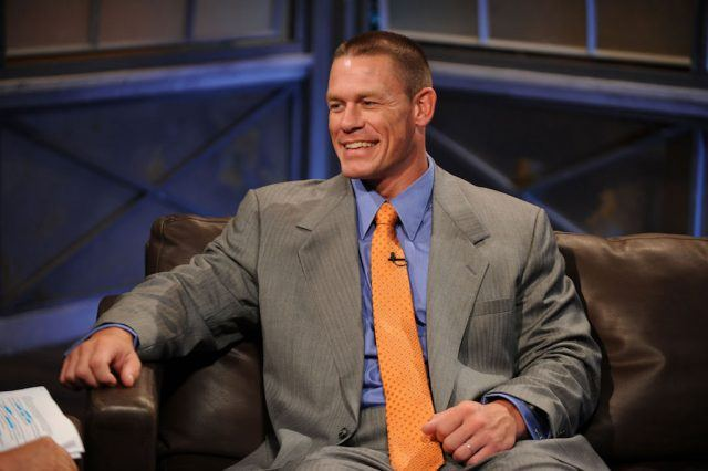 Cena sitting on a couch during an interview.