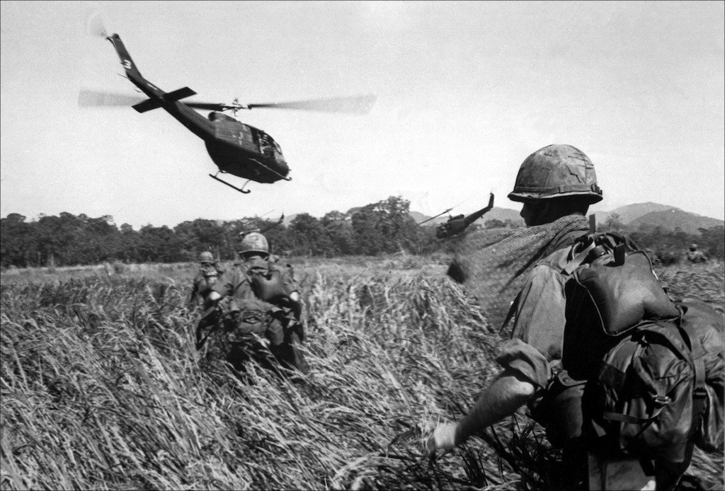 American soldiers of the 173th airborne are evacuated by helicopter from a Vietcong position in December 1965.