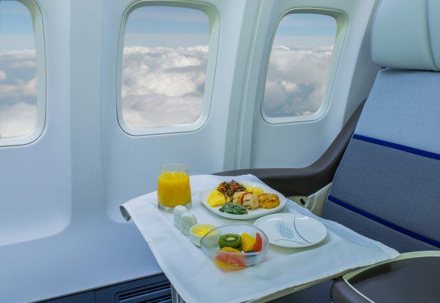 Airplane food on a tray.