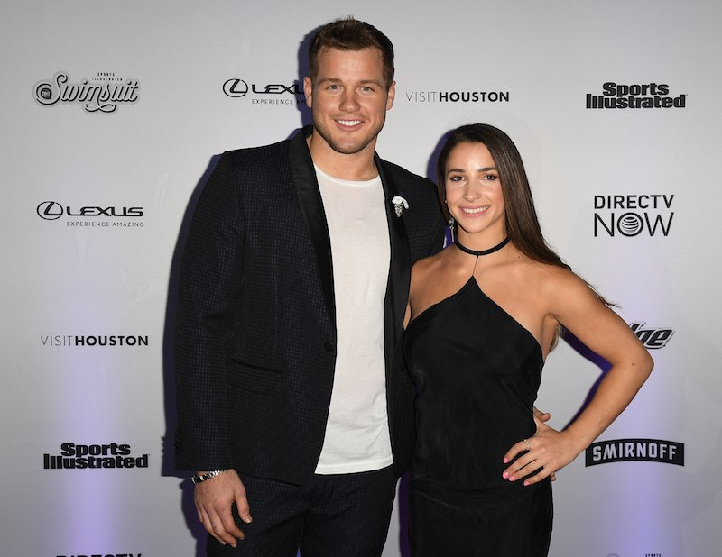 Colton Underwood (L) and Aly Raisman attend the Sports Illustrated Swimsuit 2017 launch event at Center415 Event Space on February 16, 2017 in New York City. / AFP / Angela Weiss (Photo credit should read ANGELA WEISS/AFP/Getty Images)