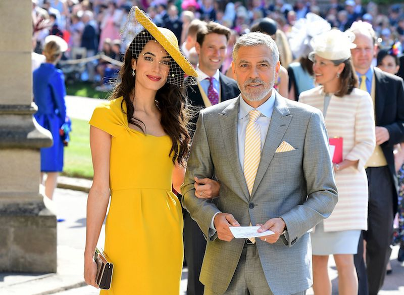 US actor George Clooney (R) and his wife British lawyer Amal Clooney (L) arrive for the wedding ceremony of Britain's Prince Harry, Duke of Sussex and US actress Meghan Markle at St George's Chapel, Windsor Castle, in Windsor, on May 19, 2018. (Photo by Ian West / POOL / AFP) (Photo credit should read IAN WEST/AFP/Getty Images)