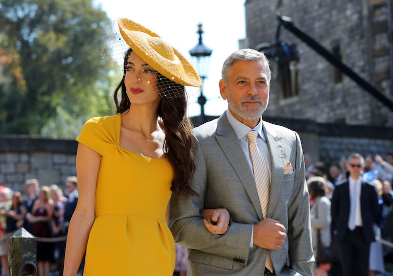 WINDSOR, UNITED KINGDOM - MAY 19: Amal Clooney and George Clooney arrive at St George's Chapel at Windsor Castle before the wedding of Prince Harry to Meghan Markle on May 19, 2018 in Windsor, England. (Photo by Gareth Fuller - WPA Pool/Getty Images)