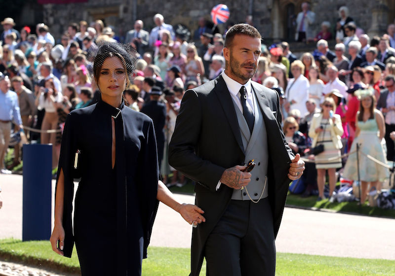 WINDSOR, UNITED KINGDOM - MAY 19: Victoria Beckham and David Beckham arrives for the wedding ceremony of Britain's Prince Harry and US actress Meghan Markle at St George's Chapel, Windsor Castle on May 19, 2018 in Windsor, England. (Photo by Chris Radburn - WPA Pool/Getty Images)