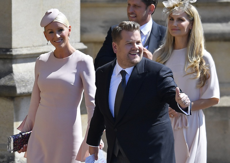 British presenter James Corden and Julia Carey arrive for the wedding ceremony of Britain's Prince Harry, Duke of Sussex and US actress Meghan Markle at St George's Chapel, Windsor Castle, in Windsor, on May 19, 2018. (Photo by TOBY MELVILLE / POOL / AFP) (Photo credit should read TOBY MELVILLE/AFP/Getty Images)