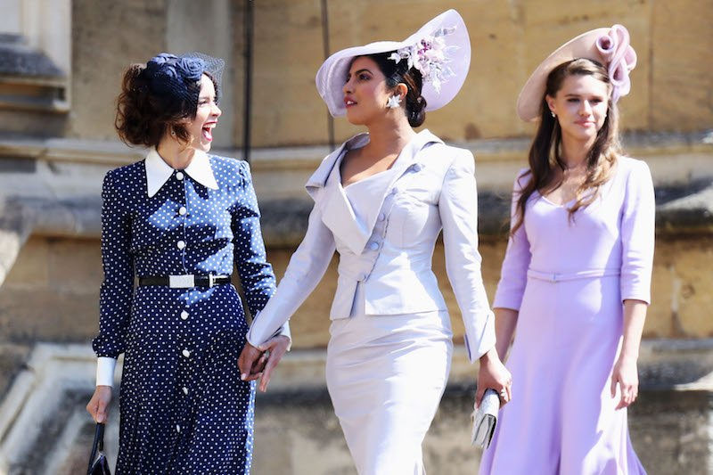 US actress Abigail Spencer and Bollywood actress Priyanka Chopra arrive for the wedding ceremony of Britain's Prince Harry, Duke of Sussex and US actress Meghan Markle at St George's Chapel, Windsor Castle, in Windsor, on May 19, 2018.