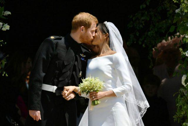 Prince Harry and Meghan Markle share their first kiss.