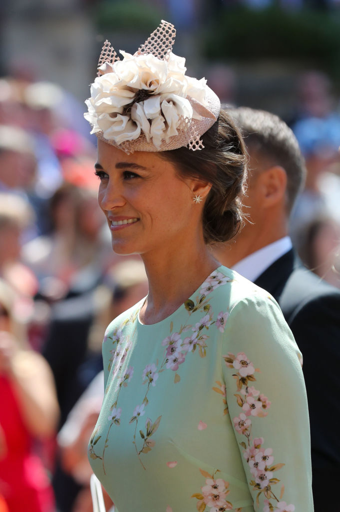 Pippa Middleton leaves St George's Chapel at Windsor Castle after the wedding of Prince Harry to Meghan Markle on May 19, 2018 in Windsor, England.