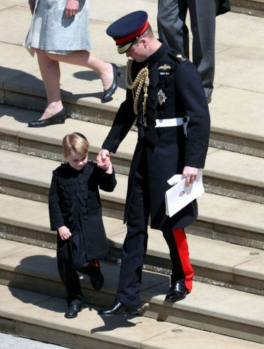 Prince William, Duke of Cambridge with Prince George leave St George's Chapel, Windsor Castle after the wedding of Prince Harry, Duke of Sussex and the Duchess of Sussex on May 19, 2018 in Windsor, England.