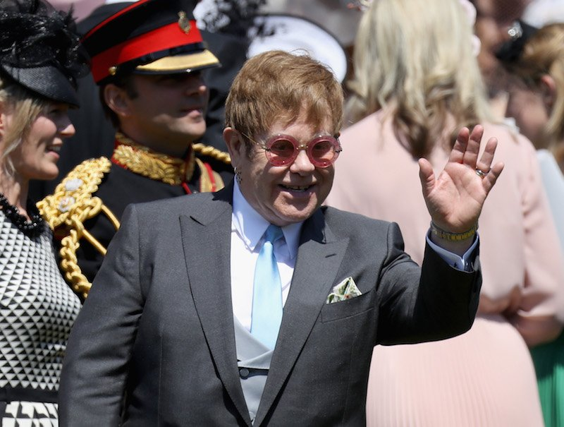 Sir Elton John arrives at the wedding of Prince Harry to Ms Meghan Markle at St George's Chapel, Windsor Castle on May 19, 2018 in Windsor, England.