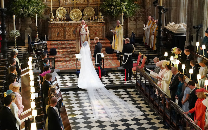 WINDSOR, ENGLAND - MAY 19: Prince Harry and Meghan Markle stand at the altar at St George's Chapel on May 19, 2018 in Windsor, England. (Photo by Owen Humphreys - WPA Pool/Getty Images)