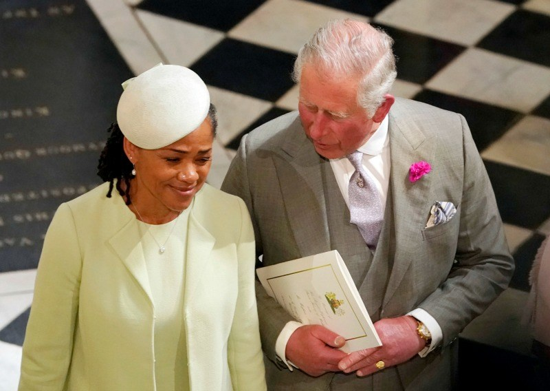Prince Charles, Prince of Wales and Doria Ragland, mother of the bride, depar after the wedding of Prince Harry and Meghan Markle at St George's Chapel at Windsor Castle