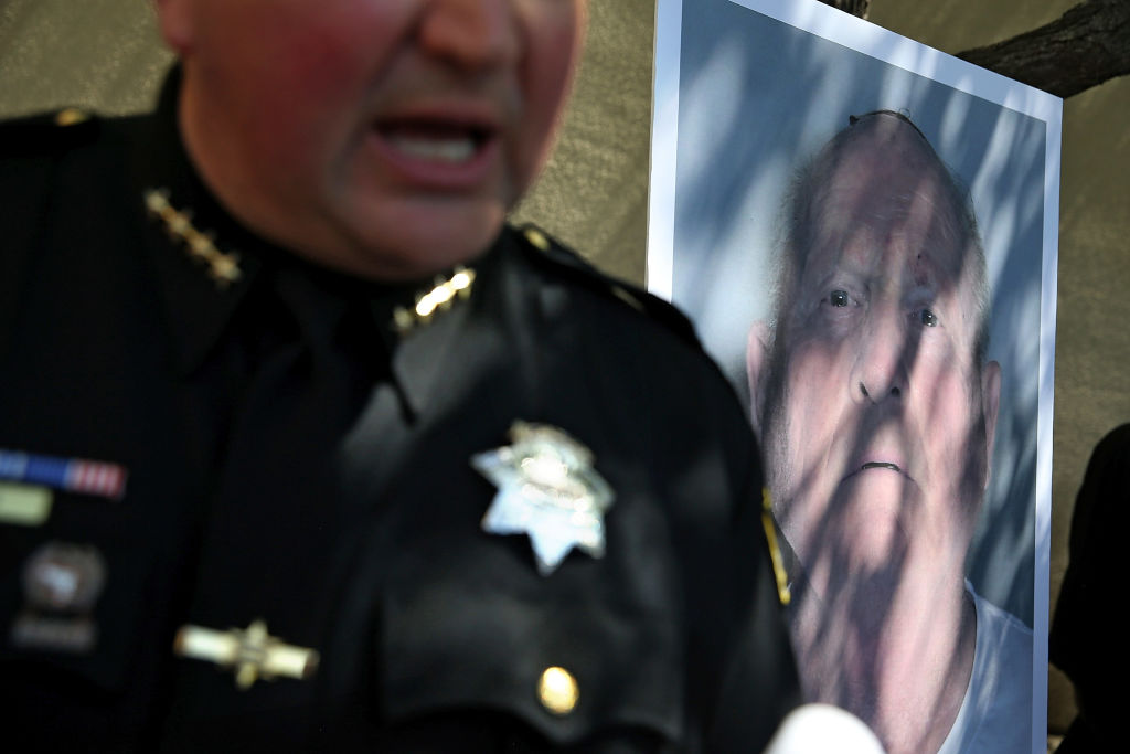 A photo of accused rapist and killer Joseph James DeAngelo is displayed during a news conference on April 24, 2018 in Sacramento, California.