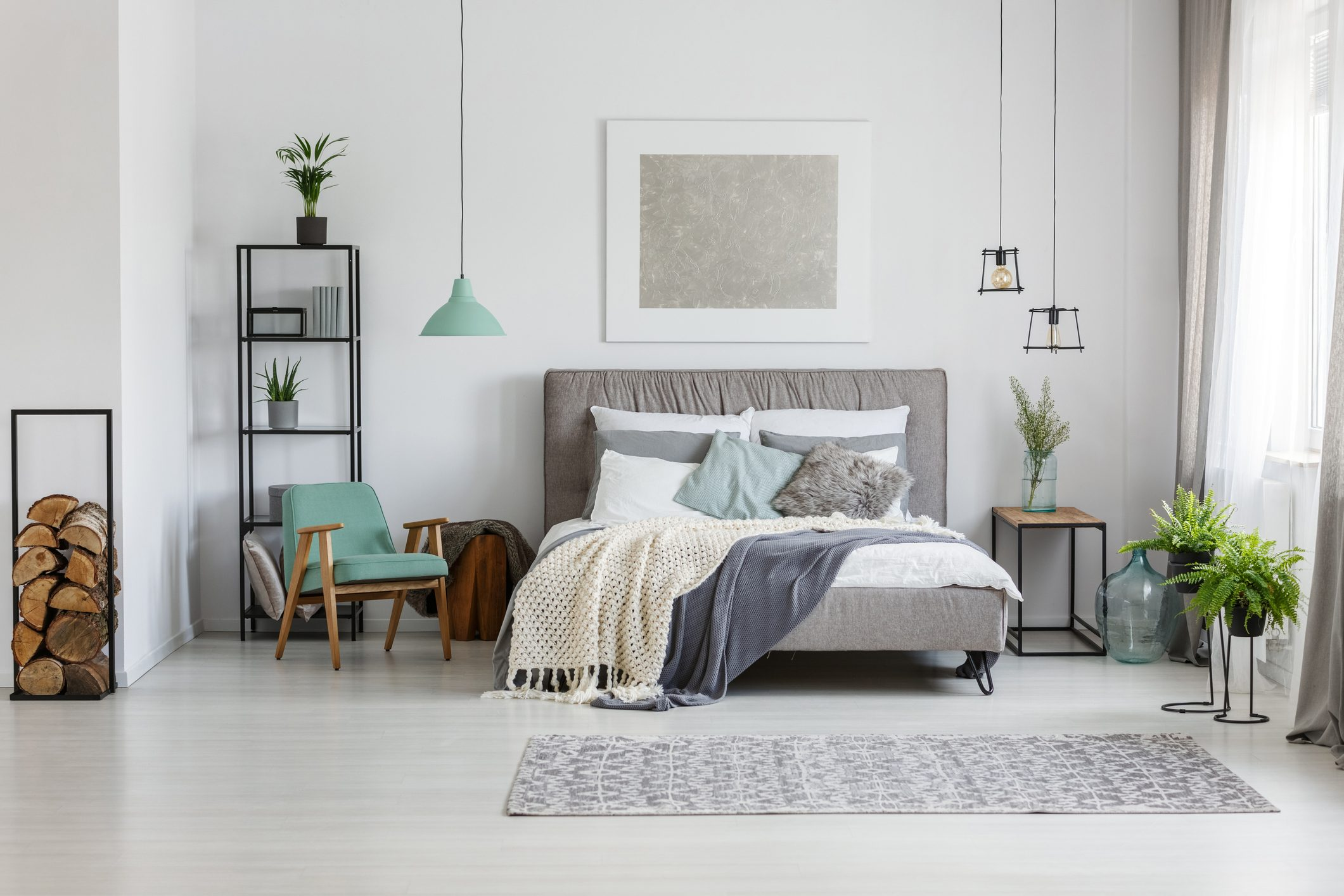 Gray and white bedroom with plants