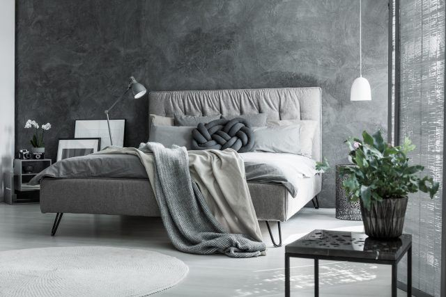 Gray bedroom with handmade pillow