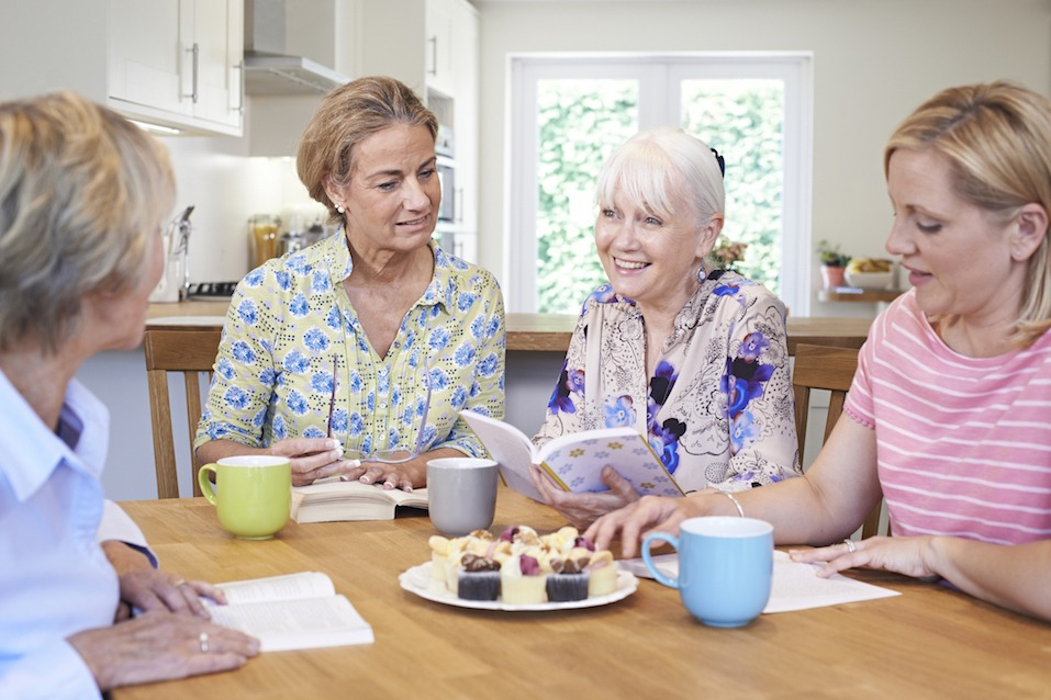 Group Of Women Meeting For Book Group