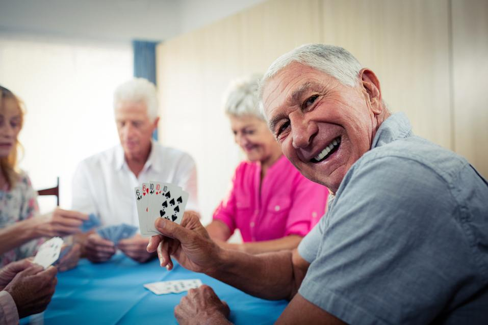 Group of seniors playing cards